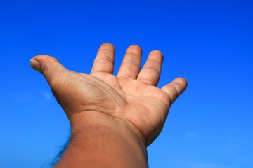 hand open on sky background