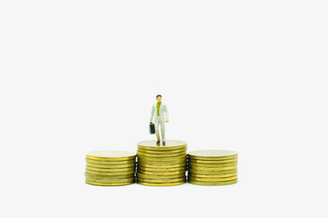 Miniature people manager stand on coins
