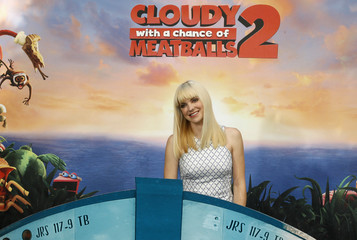 """Actress Faris, one of the voice talents from the new Sony Pictures Animation film """"Cloudy with a Chance of Meatballs 2"""", poses during a photo call in Beverly Hils, California"""
