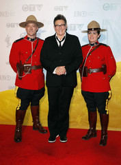 Canadian musician Lang poses with members of the Royal Canadian Mounted Police on the red carpet during the Juno Awards in Regina.