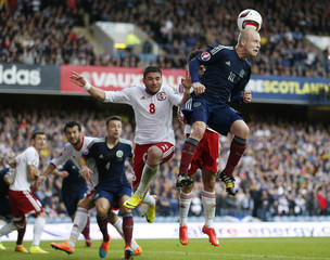 Scotland's Naismith is challenged by Georgia's Daushvili  during their Euro 2016 qualification match in Glasgow
