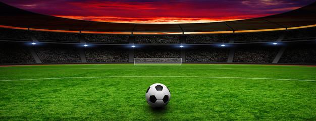 Soccer ball on green stadium