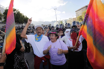 Ecuadorean Indian demonstrators shout slogans during a protest outside the National Assembly Building in Quito