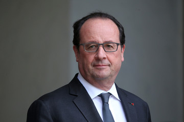 French President Francois Hollande waits for a guest at the Elysee Palace in Paris