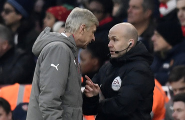 Arsenal manager Arsene Wenger clashes with fourth official Anthony Taylor before being sent to the stands