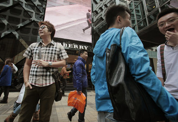 Mainland Chinese visitors stand outside a Burberry store in Hong Kong