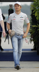Mercedes Formula One driver Nico Rosberg of Germany arrives for the first practise of the Malaysian F1 Grand Prix at the Sepang circuit