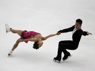 Sui Wenjing and Han Cong of China perform at pairs short program during China ISU Grand Prix of Figure Skating in Beijing