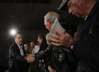 U.S. Republican presidential candidate Romney shakes hands with war veterans in Hilton Head