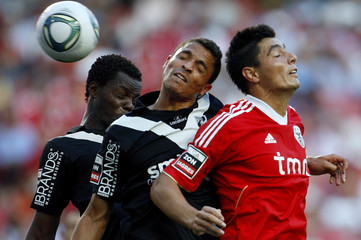 Benfica's Cardozo jumps for the ball with Vitoria Guimaraes Olimpio and N'diaye during during their Portuguese Premier League soccer match in Lisbon