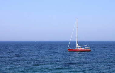 Lonely yacht in sea in summer in southern resort during vacation