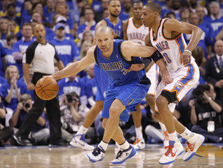 Mavericks' Kidd is guarded by Thunder's Westbrook during Game 3 of the NBA Western Conference Final basketball playoffs in Oklahoma City