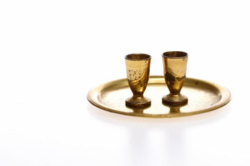 goblets on golden tray isolated on white