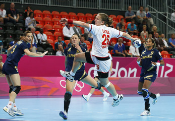 Montenegro's Suzana Lazovic shoots to score against Spain during their women's semi-final match at the Basketball Arena during the London 2012 Olympic Games