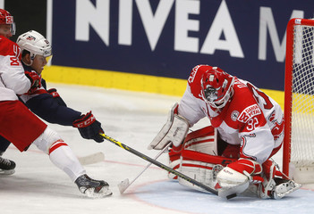 Denmark's goaltender Dahm defends against Morin of the U.S. during their Ice Hockey World Championship game at the CEZ arena in Ostrava