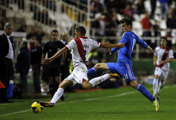Real Madrid's Bale fights for the ball with Rayo Vallecano's Nacho during their Spanish first division soccer match in Madrid