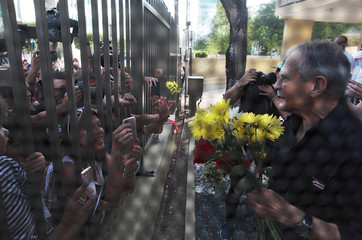 Puerto Rican Oscar Lopez Rivera greets followers after being released from house arrest in San Juan