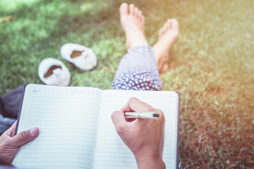 Women write notes Nature trails, mountains, forests. Writer
