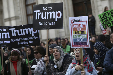 Demonstrators hold placards during a march against U.S. President Donald Trump in London
