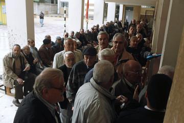 Seniors queue to vote in referendum at a school in Alexandria