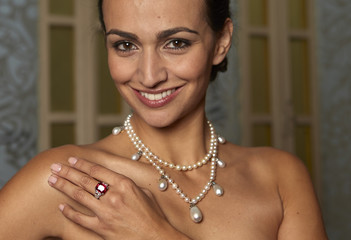 """A model wears the """"Graff Ruby"""" and a natural pearl and diamond  necklace during an auction preview Sotheby's auction house in Geneva"""