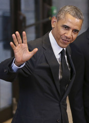 U.S. President Barack Obama waves as he arrives for the G7 summit at the European Council building in Brussels