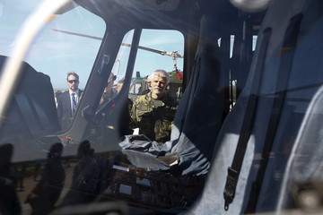 General Petr Pavel, chairman of NATO Military Committee, looks inside a helicopter during a NATO military exercise at the Birgi NATO Airbase in Trapani