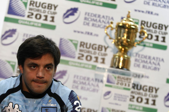 Uruguay's rugby team captain Arboleya listens to questions during a news conference as the Webb Ellis Cup trophy is displayed in the background in Bucharest