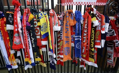 Scarves are tied to a gate by the Hillsborough memorial ahead of the English Premier League soccer match between Liverpool and Manchester City at Anfield