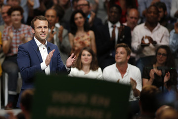 French Economy Minister Emmanuel Macron attends a political rally for his recently launched political movement, En Marche!, or Forward!, in Paris