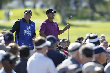 Tiger Woods waits to tee off with his caddie, Steve Williams, on the fourth hole in first round play on Torrey Pines North course during the Farmers Insurance Open PGA golf tournament in San Diego
