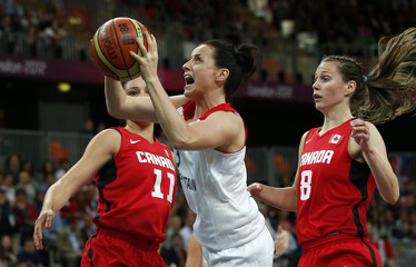 Great Britain's Anderson goes between Canada's Achonwa and Smith during their women's preliminary round Group B basketball match at the Basketball Arena during the London 2012 Olympic Games