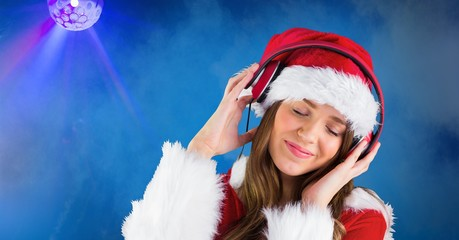 Woman wearing Santa hat while listening music