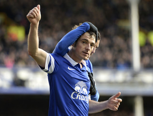 Everton's Baines celebrates after scoring a penalty against Swansea during their English FA Cup fifth round soccer match at Goodison Park in Liverpool, northern England