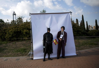Participants wearing superhero costumes pose for a picture during the World DC Comics Super Heroes event in San Martin de Valdeiglesias, near Madrid