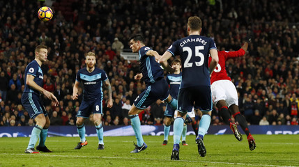 Manchester United's Paul Pogba (hidden) scores their second goal