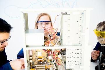 Female technician repairing a computer