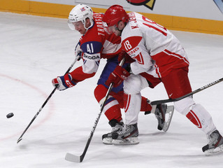 Denmark's Kasper Jensen fights for puck with Norway's Thoresen during their 2012 IIHF men's ice hockey World Championship game in Stockholm