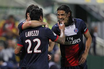 Paris Saint-Germain's Lavezzi celebrates with team mate Cavani after scoring against  FC Nantes at the Beaujoire stadium in Nantes