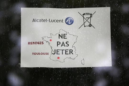 A map of France displays the Alcatel-Lucent sites in the French cities of Rennes and Toulouse on a flyer at the entrance of the company site building in Rennes