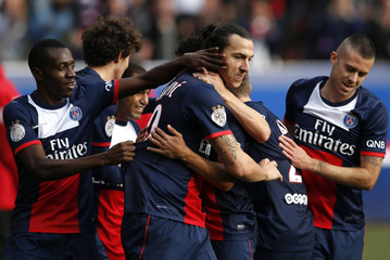 Paris St Germain's Ibrahimovic celebrates with team-mates after scoring a goal for the team during their French Ligue 1 soccer match against Bastia in Paris