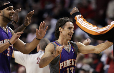 Suns guard Nash celebrates with teammates after defeating the Trail Blazers in Portland