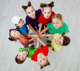 Adorable kids standing around, top view