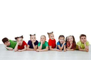 Adorable children lying on the belly, isolated on a over white background