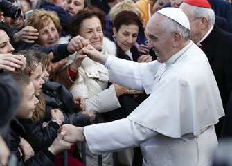 Pope Francis greets faithful as he arrives for his pastoral visit at the Saint Tommaso parish in the outskirts of Rome