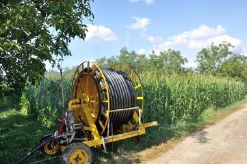 Water sprinkler installation in a field