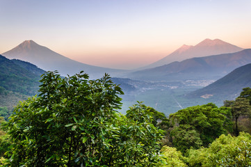 Dawn over three volcanoes: Agua, Fuego & Acatenango, near Antigua, Guatemala, Central America