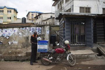 Moses Udoh, an employee of online retailer Jumia, makes a delivery by motorcycle in Lagos