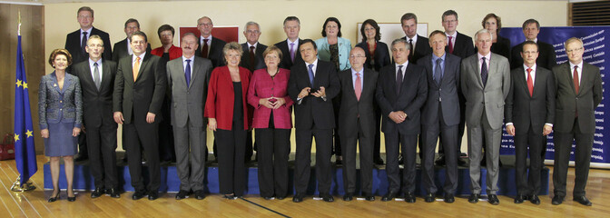 German Chancellor Merkel and European Commission President Barroso pose for a family photo in Brussels