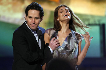 Paul Rudd grabs the breast of Eva Mendes as they present an award at the Film Independent Spirit Awards in Santa Monica